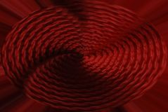 Abstract background knitted fabric, with a spiral in the center. Red-orange royalty free illustration