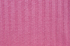 Abstract background knitting yarn. Abstract background small pattern of pink knitting yarn Royalty Free Stock Photo