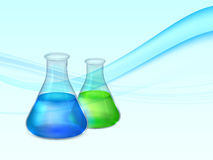 Abstract background with lab flasks with green and blue fluids and bubbles Royalty Free Stock Photos