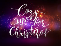 Abstract background with lettering. Abstract background with sparks lights and handwritten Cozy up for Christmas Royalty Free Stock Images
