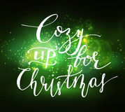 Abstract background with lettering. Abstract background with sparks lights and handwritten Cozy up for Christmas Stock Image