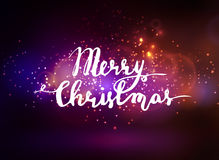 Abstract background with lettering. Abstract background with sparks lights and handwritten Merry Christmas Stock Photos