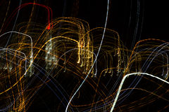 Abstract background of light bulbs at night in motion Stock Photo