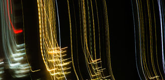 Abstract background of light bulbs at night in motion Royalty Free Stock Image