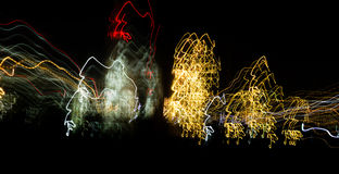 Abstract background of light bulbs at night in motion Stock Photos