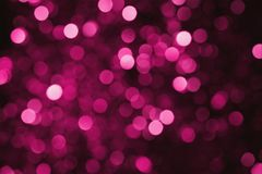 Abstract background of light spots of burgundy color, glare of light on maroon surface. Abstract background of light spots of burgundy color, glare of light on Royalty Free Stock Images