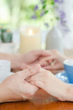 Abstract background of lovers couple holding hands on coffee tab Royalty Free Stock Photos