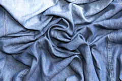 Abstract background luxury  circle flower wave or wavy folds of jeans texture Royalty Free Stock Photos