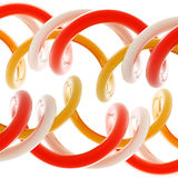 Abstract background made of bright plastic whorls. Abstract glossy background made of bright plastic red, orange, white twirls Stock Images