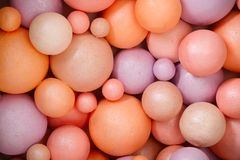 Abstract background made of colored different size styrofoam balls Royalty Free Stock Images