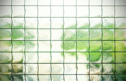 Abstract background made of glass with grating. Royalty Free Stock Photos