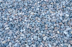 Abstract background made of stones. A large variety of rough stones featuring many shades of bluish color Royalty Free Stock Photos