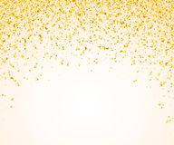 Abstract background with many falling golden tiny confetti pieces. Stock Photo