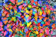 Abstract background many small stones painted with colored paint Stock Photo