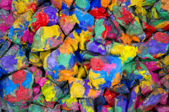 Abstract background many small stones painted with colored paint Stock Photography