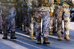 Abstract background on military theme. Soldier rank, legs, close-up. Front view. - image.  royalty free stock photo