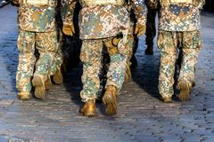 Abstract background on military theme. Soldier rank, legs, close-up. Rear view. - image.  stock photo