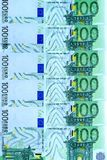 Abstract background of money from banknotes of 100 euros Royalty Free Stock Images