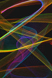 Abstract background with moving light trails. Abstract with bright light trails on black background Stock Image