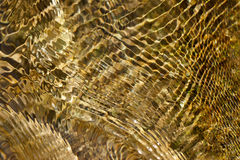 Abstract background of moving water. Crisscrossing pattern of ripples in a stream Stock Photography