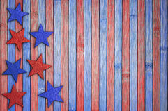 Abstract background in the national United States colors. Red and blue stars on table. Patriotic American background in national colors Stock Photos