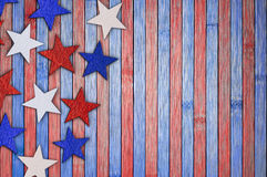 Abstract background in the national United States colors. Red, white and blue stars on table. Patriotic American background in national colors Stock Image