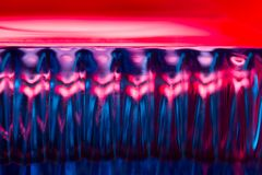 Abstract background in neon light. Blue and red stock images