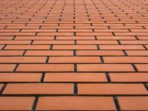 Wall of red brick, with clear seams in the background Royalty Free Stock Images