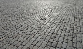 Abstract background of old cobblestone pavement. Close-up stock photos