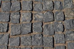 Abstract background. Old cobblestone pavement close-up. royalty free stock photo