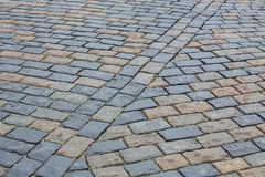 Old cobblestone pavement close-up. Stock Images