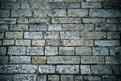 Abstract background of old cobblestone pavement. Grey stone brick paving texture. Close up of ancient road. Walking in an old city. Old bricks texture. Ancient royalty free stock photo
