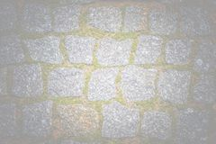 Abstract background of old cobblestone pavement texture with nat Stock Photos
