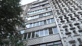 Abstract background of old paneled high-rise building. stock footage