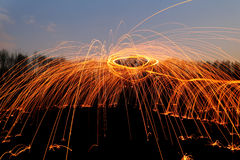 Abstract background with orange sparklers Stock Images