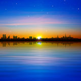 Abstract background with panorama of city and sunrise Stock Photography