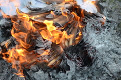 Abstract background of a paper in fire Stock Images