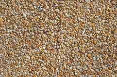 Abstract background of pebbles. Pebble stones on a wall abstract Royalty Free Stock Photography
