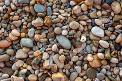 An abstract background of pebbles on the iconic Port Willunga Be. Ach in South Australia on 22nd September 2018 stock photography