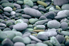 Abstract background with pebbles - round sea stones Royalty Free Stock Photos