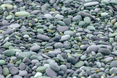 Abstract background with pebbles - round sea stones Stock Images
