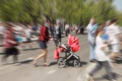 Abstract background. Pedestrians and  mother with  pram crossing Royalty Free Stock Photos