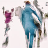 Abstract background of people hurrying down the city street back to us. Intentional motion blur. Concept of seasons. Shopping, walking, lifestyle, modern city Royalty Free Stock Image
