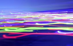 Abstract background with perspective of bright glowing neon ligh. Beautiful banner with perspective from bright glowing multicolored neon lights on a blue Royalty Free Stock Photo