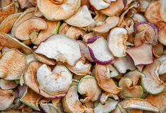 Abstract background from pieces of dried apples thinly sliced stock photography