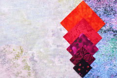Abstract background from pieces of quilting fabrics. How element of design Royalty Free Stock Photo