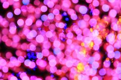 Abstract background pink and blue bokeh for decorative festive merry christmas. And celebration countdown to happy new year festival holiday in december every Stock Image