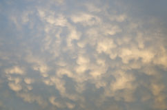 Abstract background pink height cumulus clouds on a blue sky Royalty Free Stock Photography