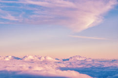 Abstract background with pink, purple and blue colors clouds. Sunset sky above the clouds. Dreamy fantasy background in soft pastel colors Royalty Free Stock Image