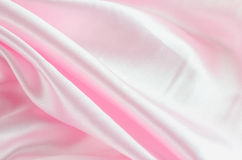 Abstract background - Pink satin textile Stock Images